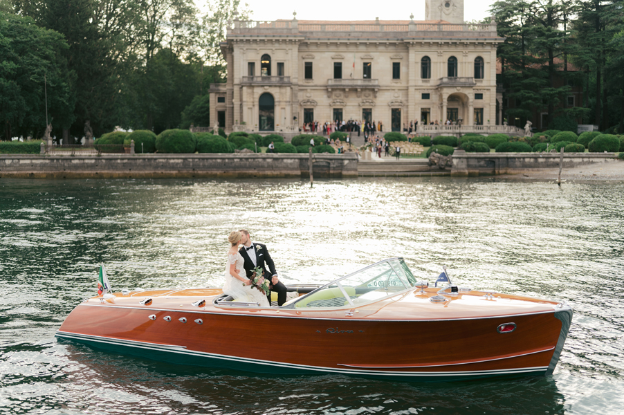 Bride-and-groom-Riva-speed-boat-italy-Lake-Como-wedding-planner