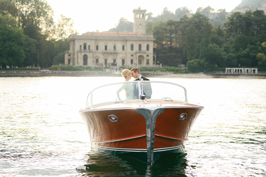 Bride-and-groom-in-Riva-speed-boat-in-front-of-Italian-villa-by-wedding-planner-My-Lake-Como-Wedding