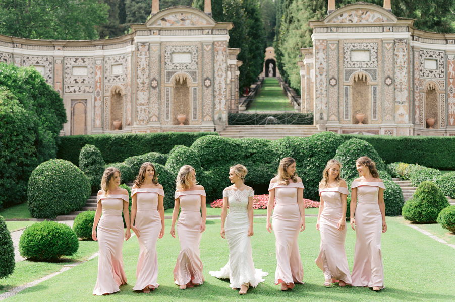 Bride-and-her-bridesmaids-walking-in-the-garden-of-Villa-dEste-by-My-Lake-Como-Wedding