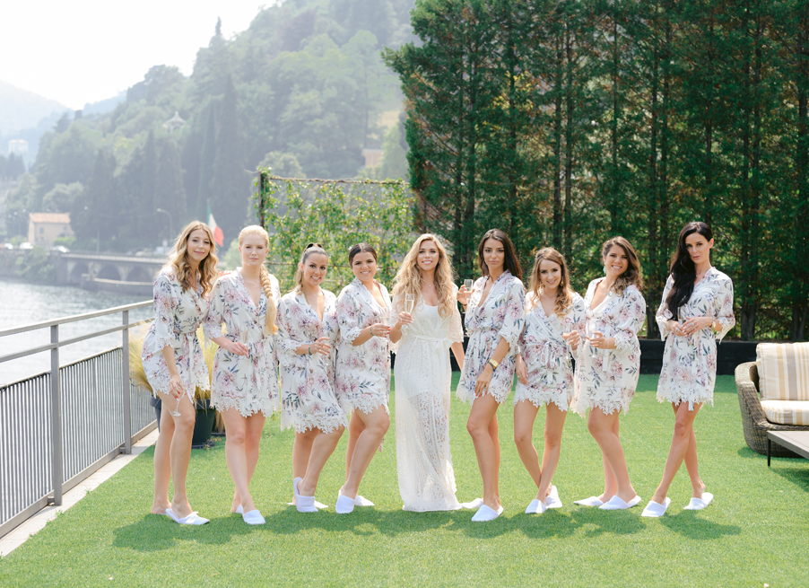 Bride-and-bridesmaids-getting-ready-for-wedding-on-hotel-room-terrace