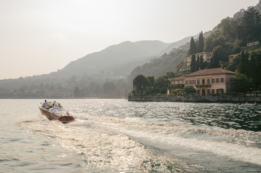 Bride-and-groom-sunset-Riva-speed-boat-cruise-on-Lake-Como