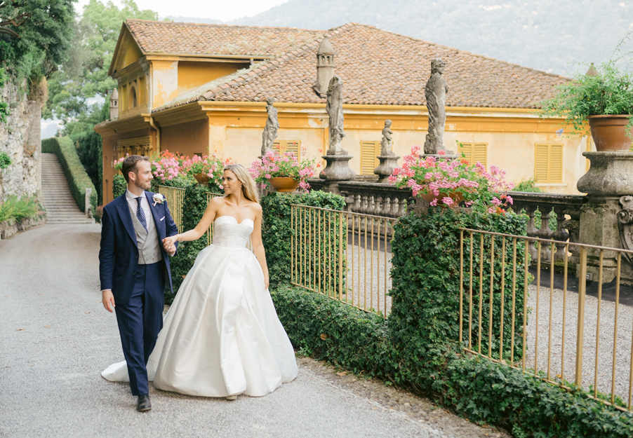 Bride-and-groom-walking-to-their-dining-terrace-at-Villa-Pizzo
