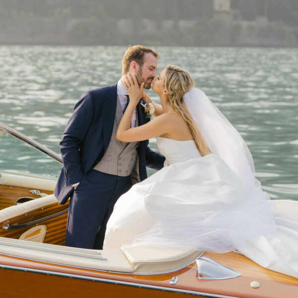 Bride-and-groom-on-riva-boat-for-love-story-blog