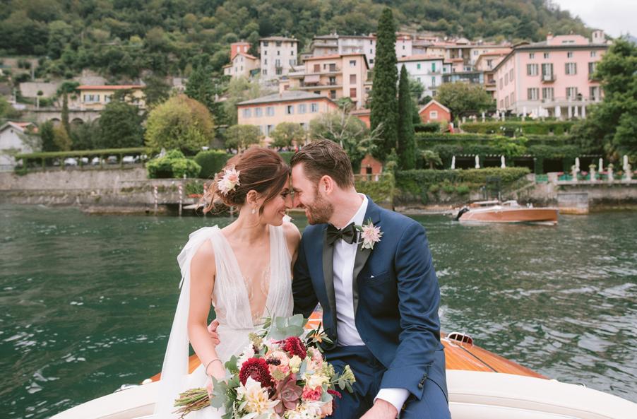 Bride-and-groom-on-speedboat-at-Villa-Teodolinda-on-Lake-Como